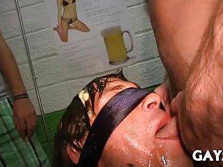 Blindfolded guy blows hard pricks