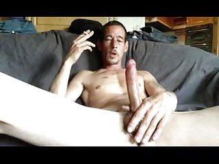 Smoking & jerking cock